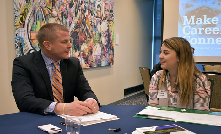 Image - male insurance professional networking with young female student.